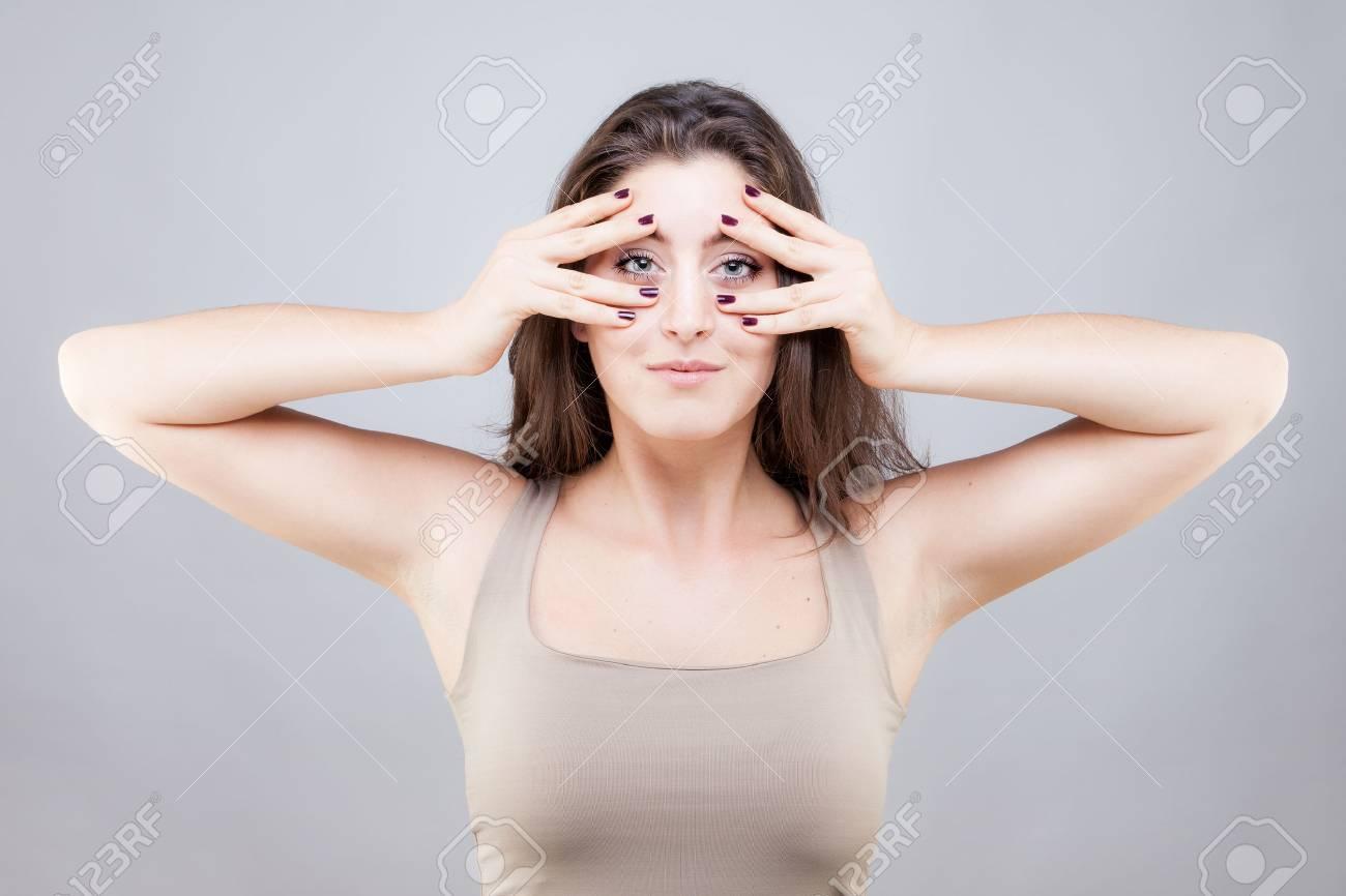Beautiful young caucasian woman doing face yoga pose - 33890188