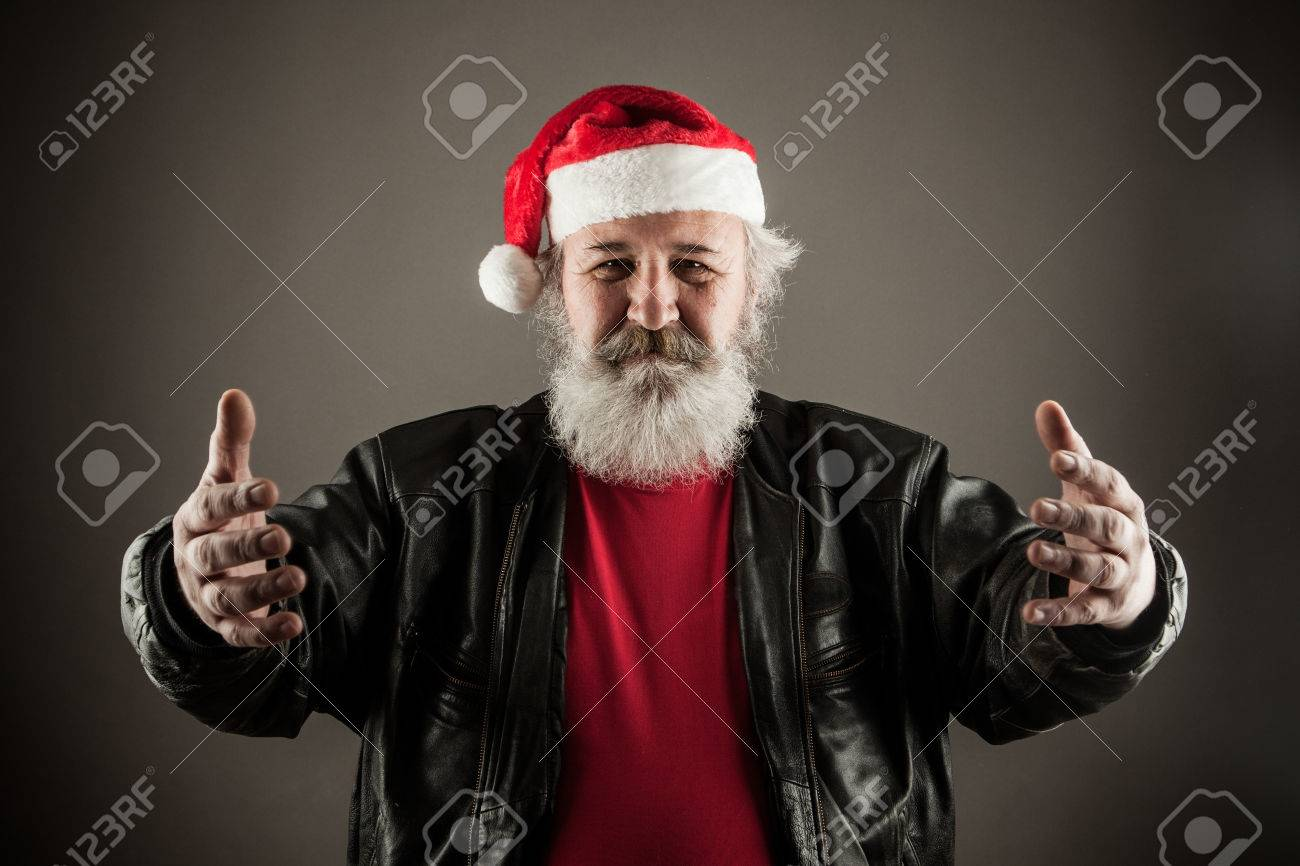Funny mature man with real beard dressed as Santa Claus Stock Photo -  35210879