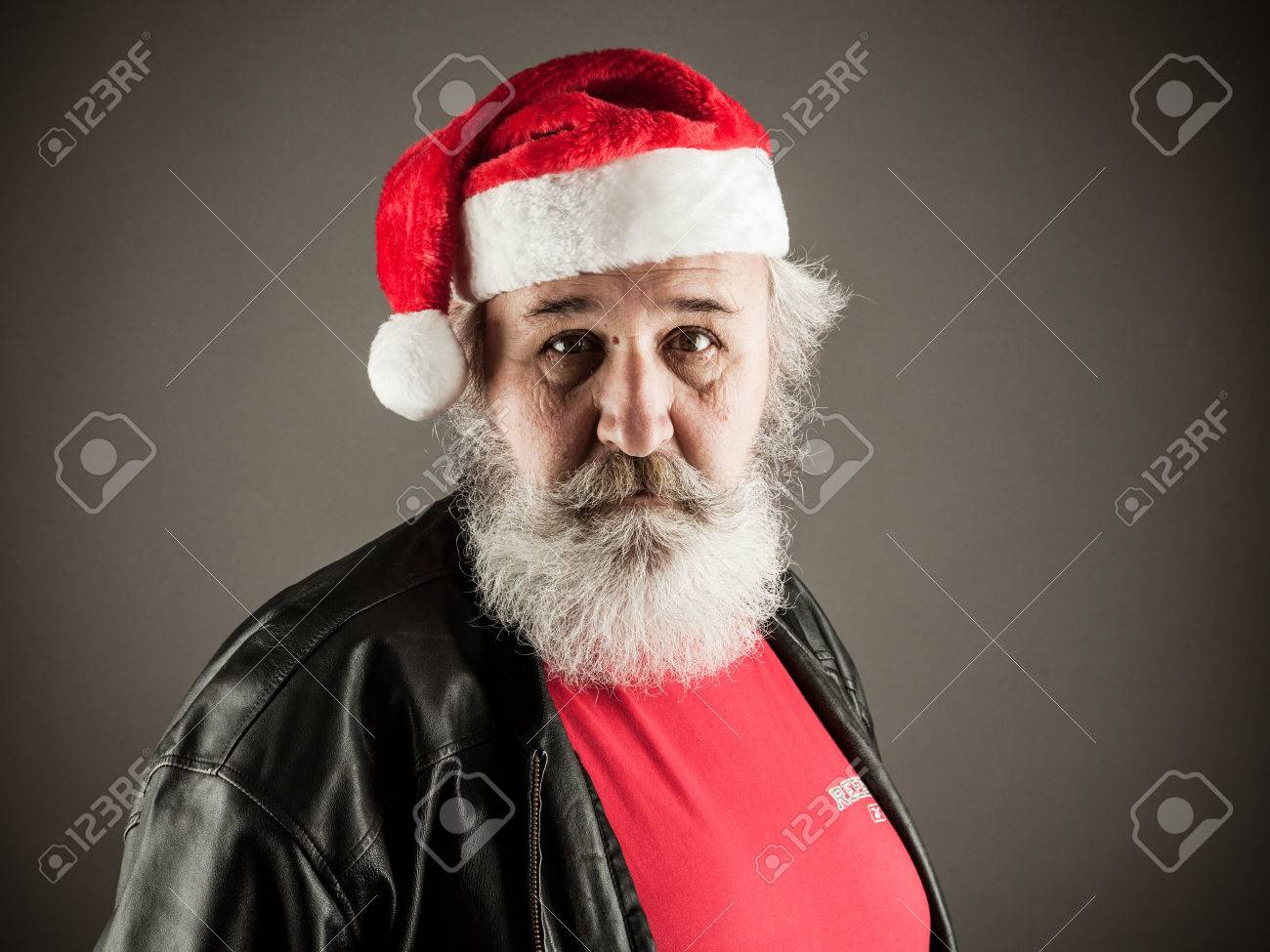 Funny mature man with real beard dressed as Santa Claus Stock Photo -  35210904