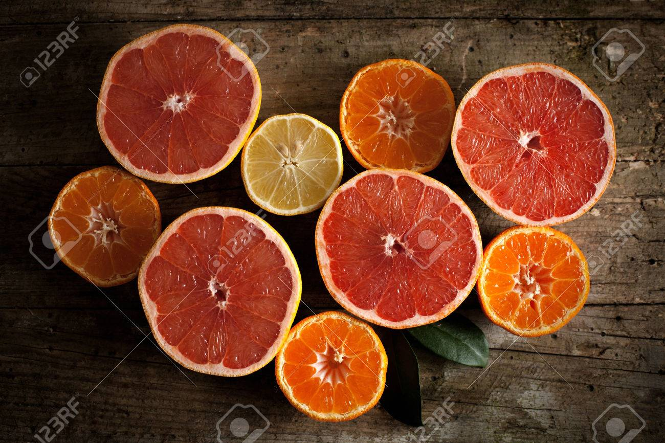 Different kind of citrus fruits on wooden board - 35972606