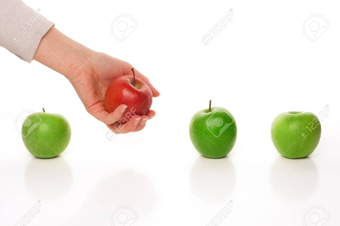 Picking different apple among other similar on white - 61448094