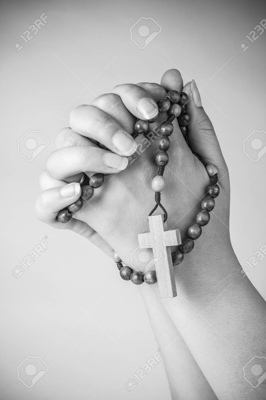 Praying Hands With Rosary Beads And Cross