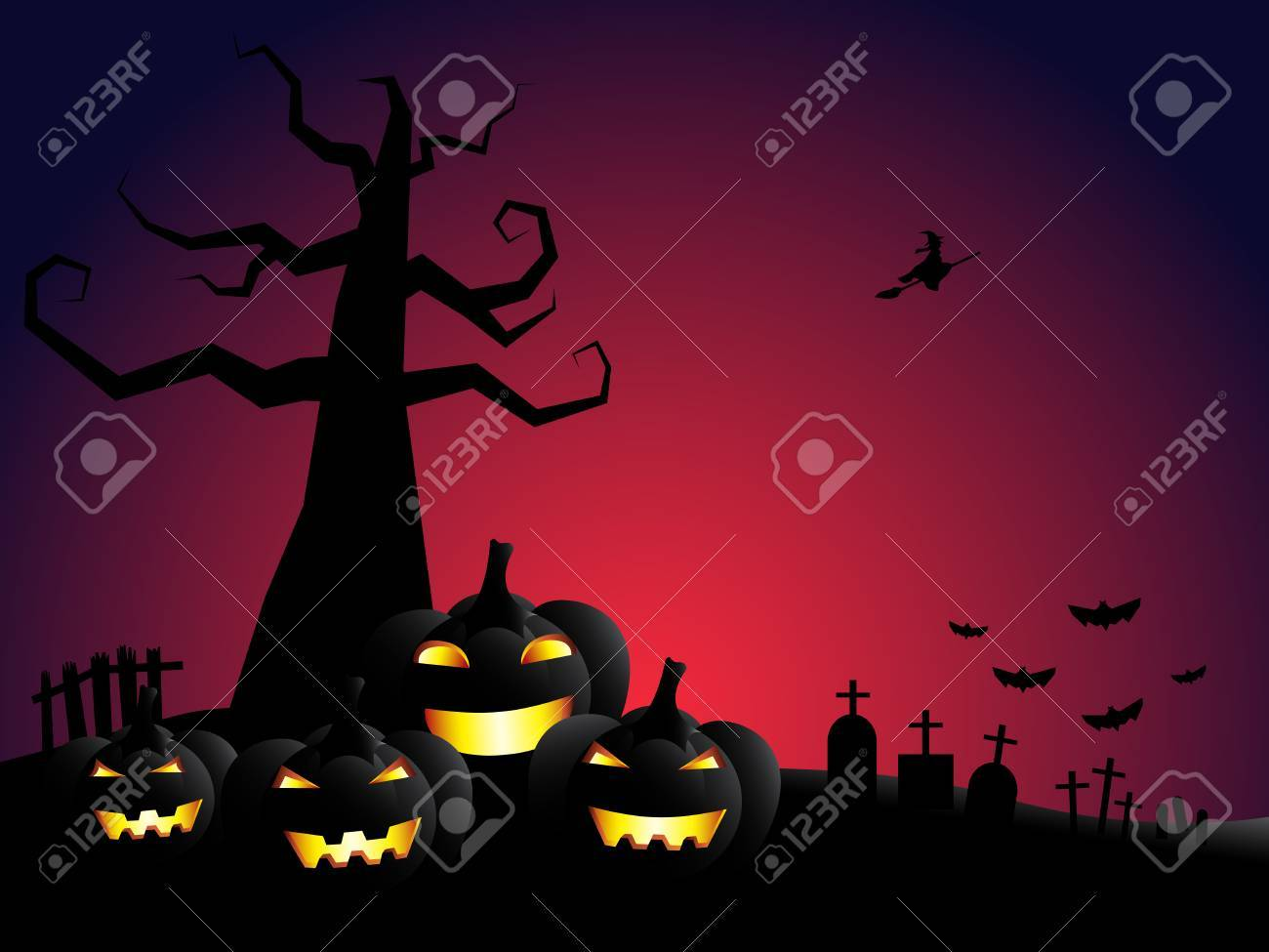 halloween pumpkin and dead tree in cemetery with bloody sky