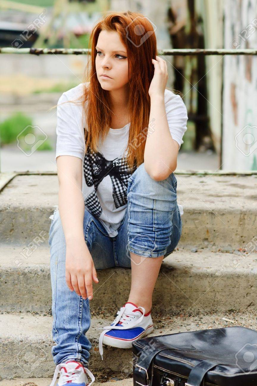 Beautiful young sad girl sitting on the staircase Stock Photo - 10703108