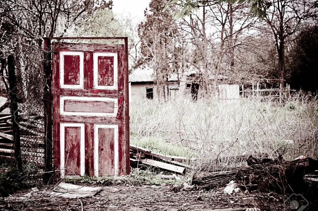 Stock Photo - The strange old door standing among the remains & The Strange Old Door Standing Among The Remains Stock Photo Picture ...