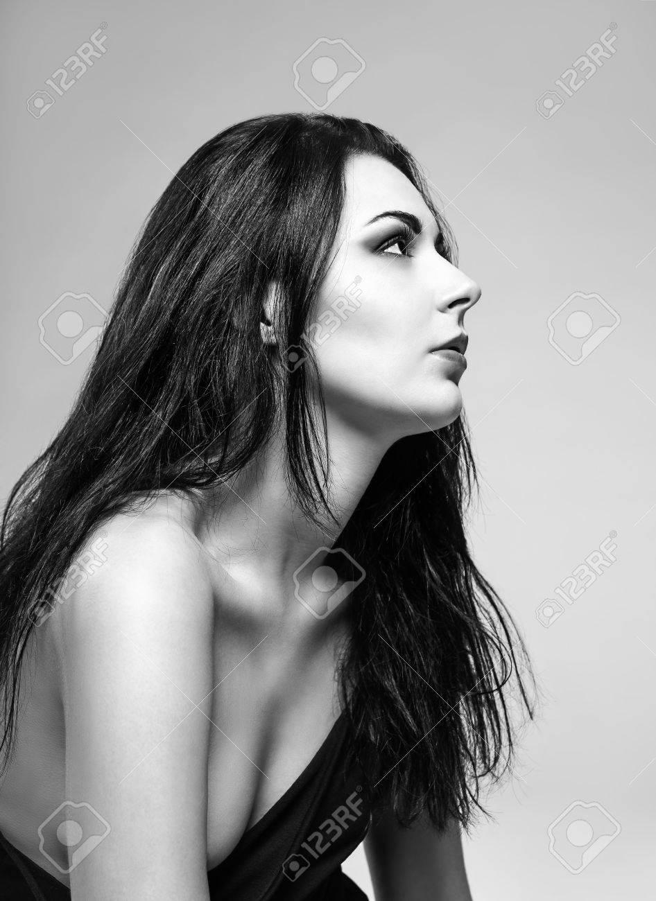 Stock photo studio portrait of a beautiful girl profile view black and white photo