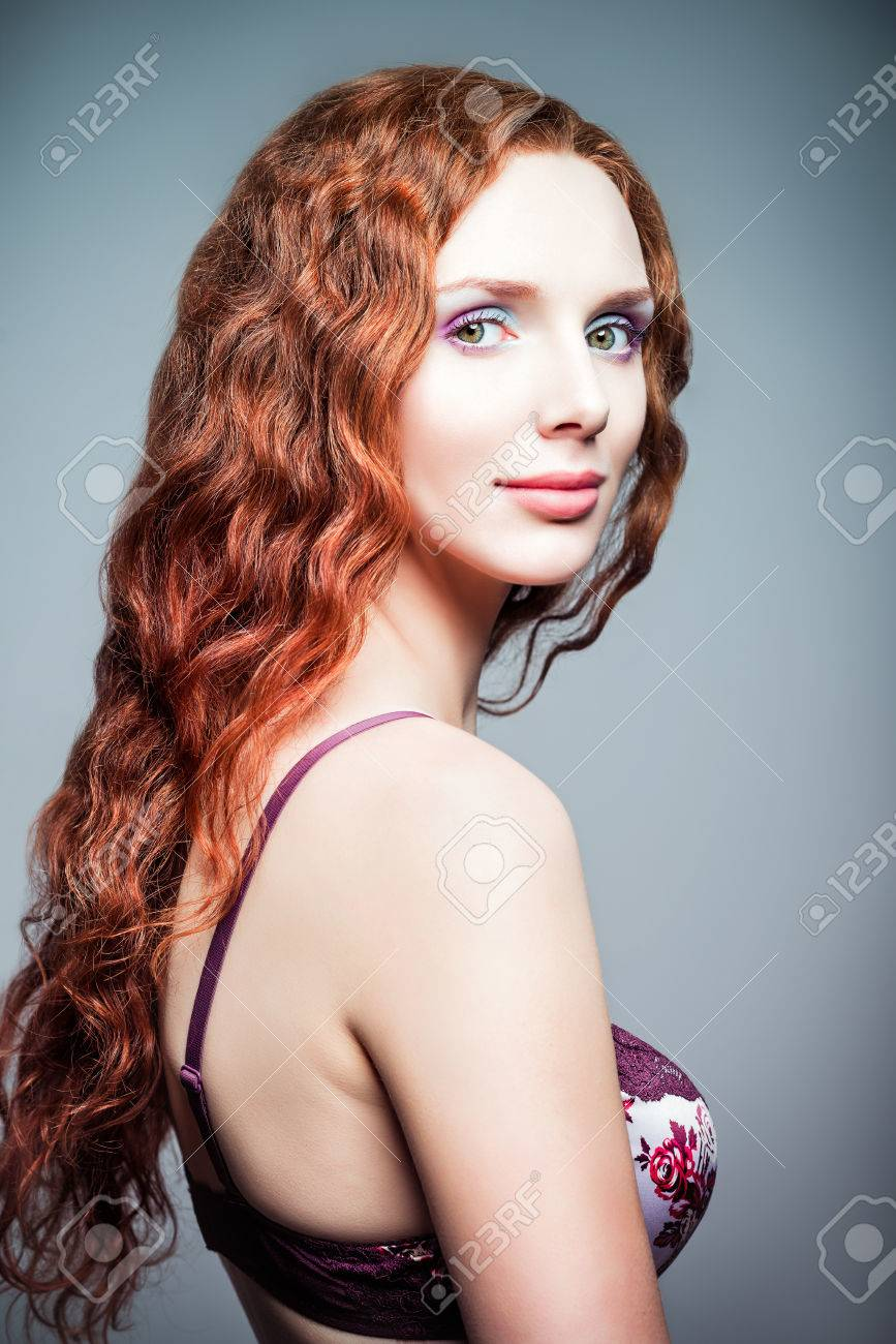 http://previews.123rf.com/images/jetrel/jetrel1408/jetrel140800003/30606610-Closeup-studio-portrait-of-a-pretty-redhead-woman-Half-turned--Stock-Photo.jpg