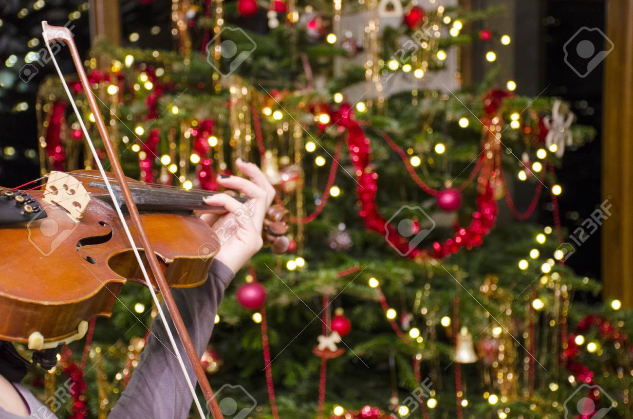 Christmas Violin.The Violin Front Of A Christmas Tree With Decoration