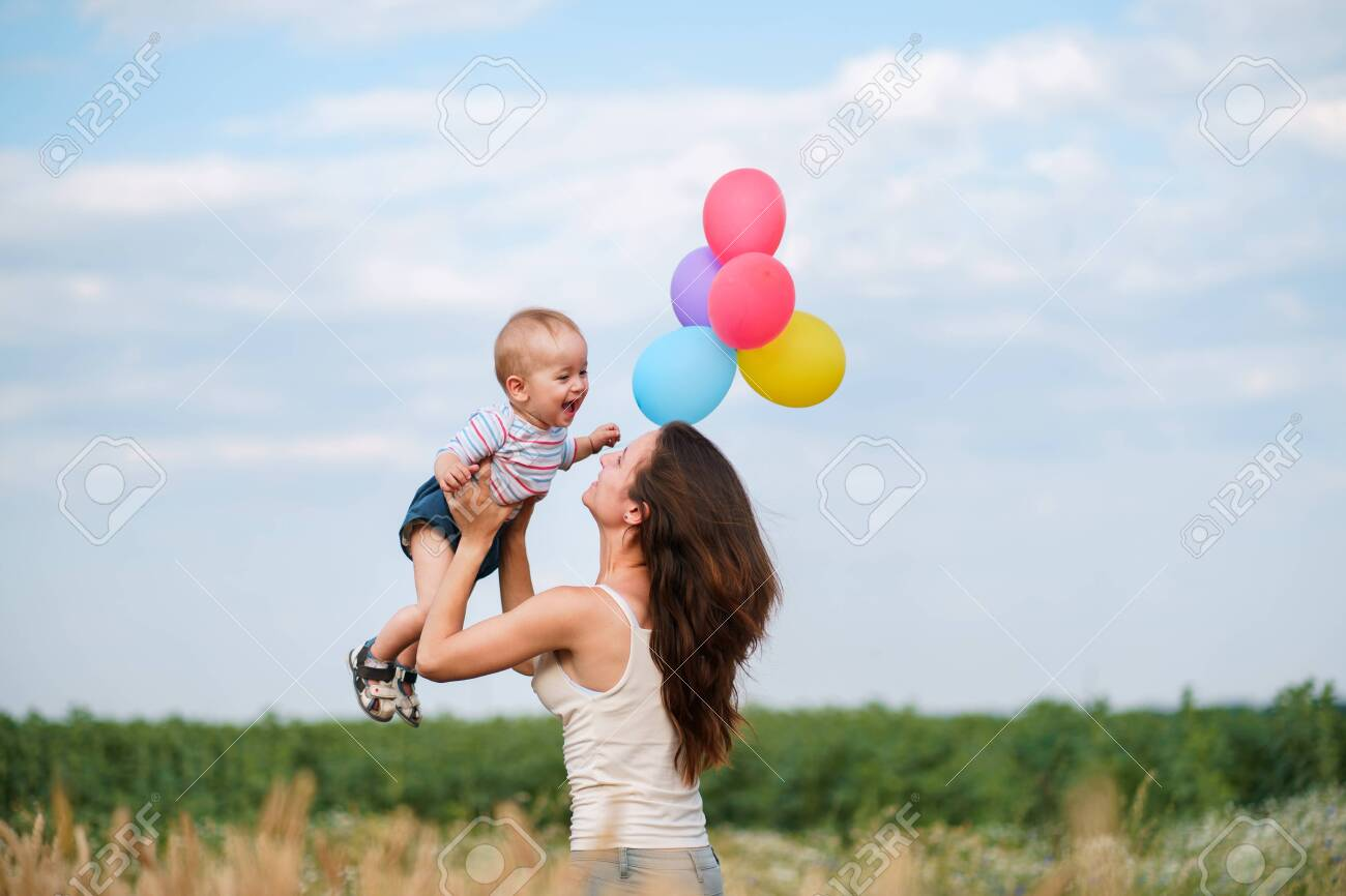 Mother and toddler son playing outdoors - 126427535