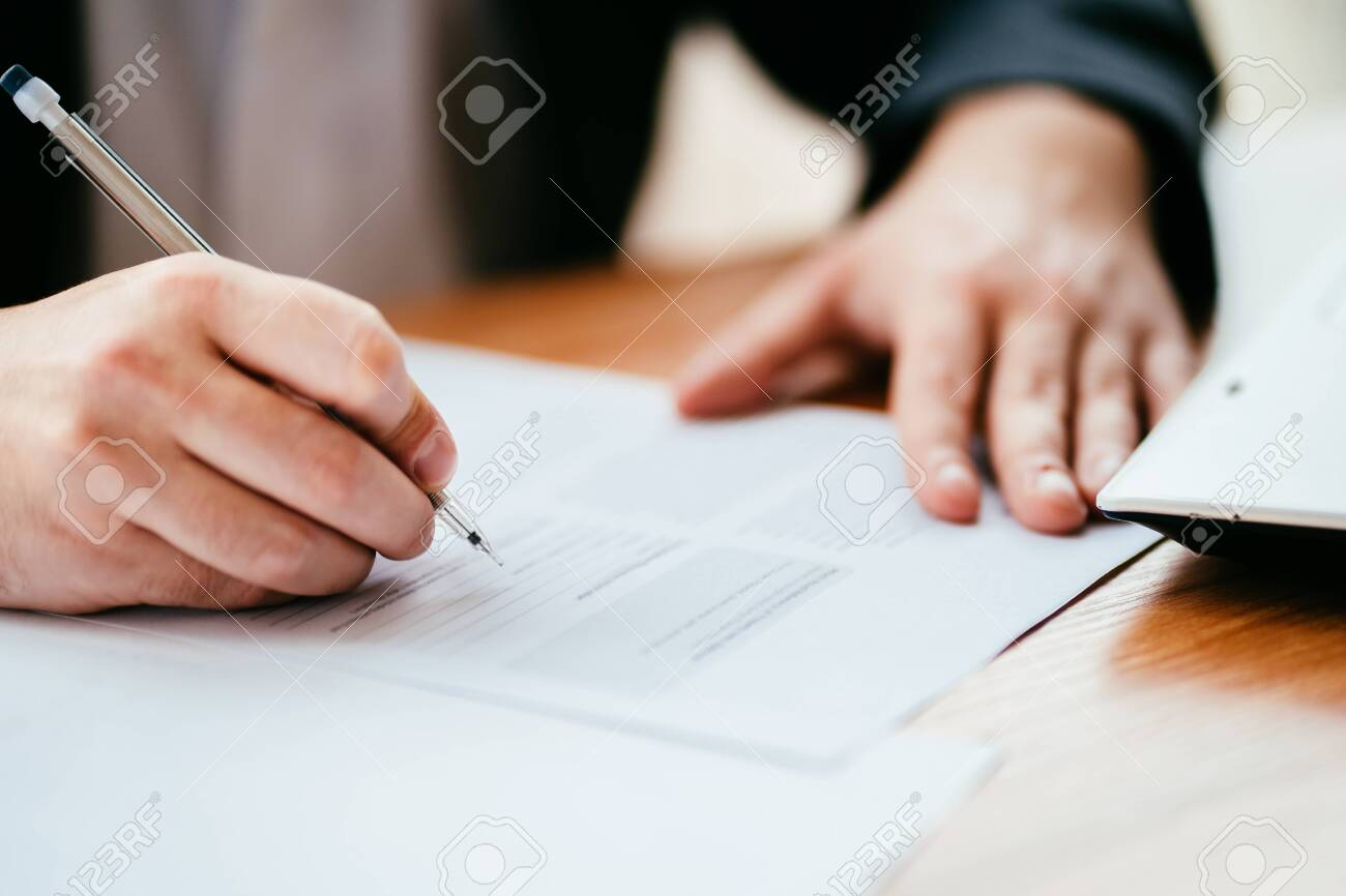 Businessman filling document, signing contract - 134276312