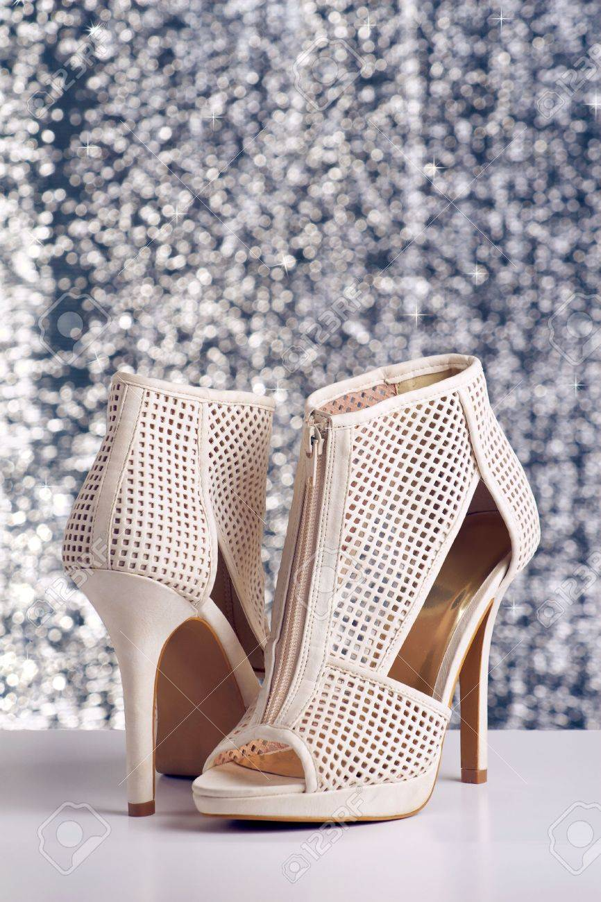 Pair of women's high heel shoes on shiny background Stock Photo - 7681481