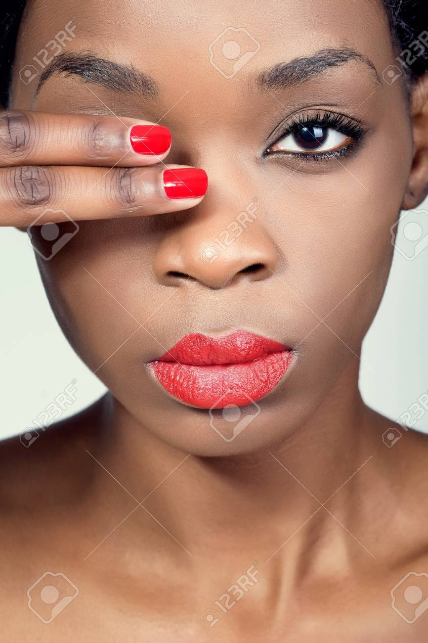 Closeup shot of a young woman with natural makeup and red lips Stock Photo - 8849261