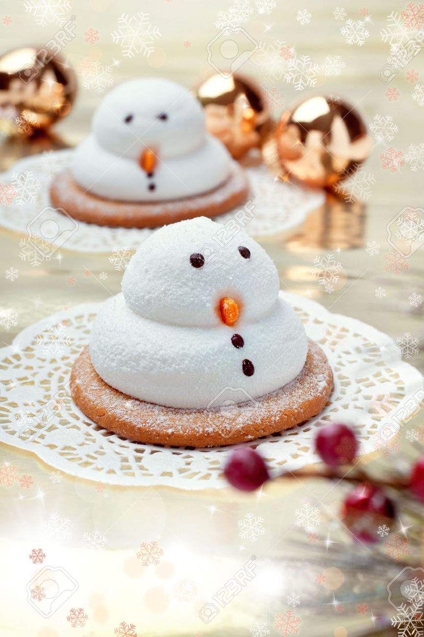 Two Traditional Marshmallow Snowmen Biscuits With Christmas Decorations