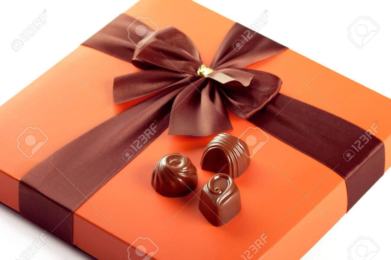 Chocolate sweets and beautiful gift box with ribbon bow, closeup shot Stock Photo - 11431908
