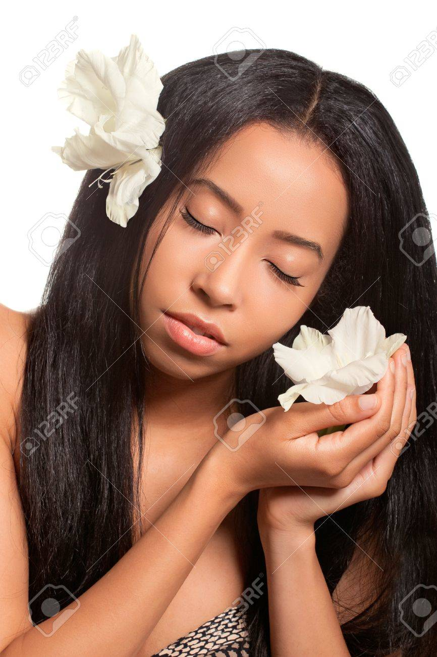 Beautiful young woman with golden tan and flowers in her hair and hands, relaxation/holiday/beach concept Stock Photo - 12921569