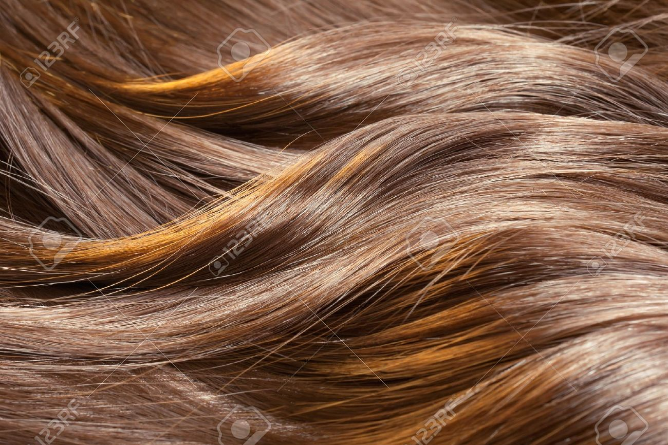 Beautiful healthy shiny hair texture with highlighted golden streaks Stock Photo - 12921655