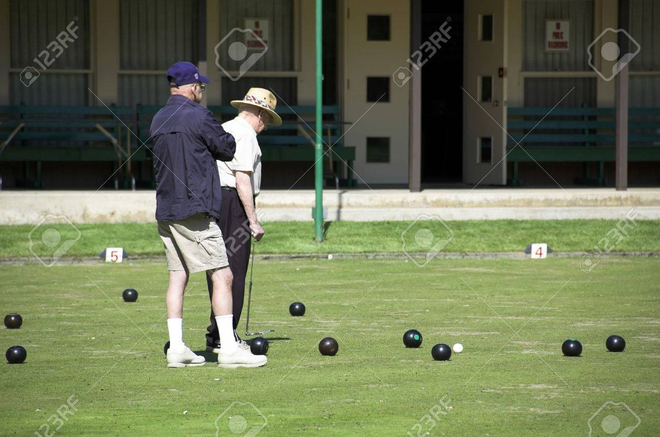 Elderly lawn bowlers play at the lawn bowling club on the legislative grounds in Edmonton. Stock Photo - 3113953