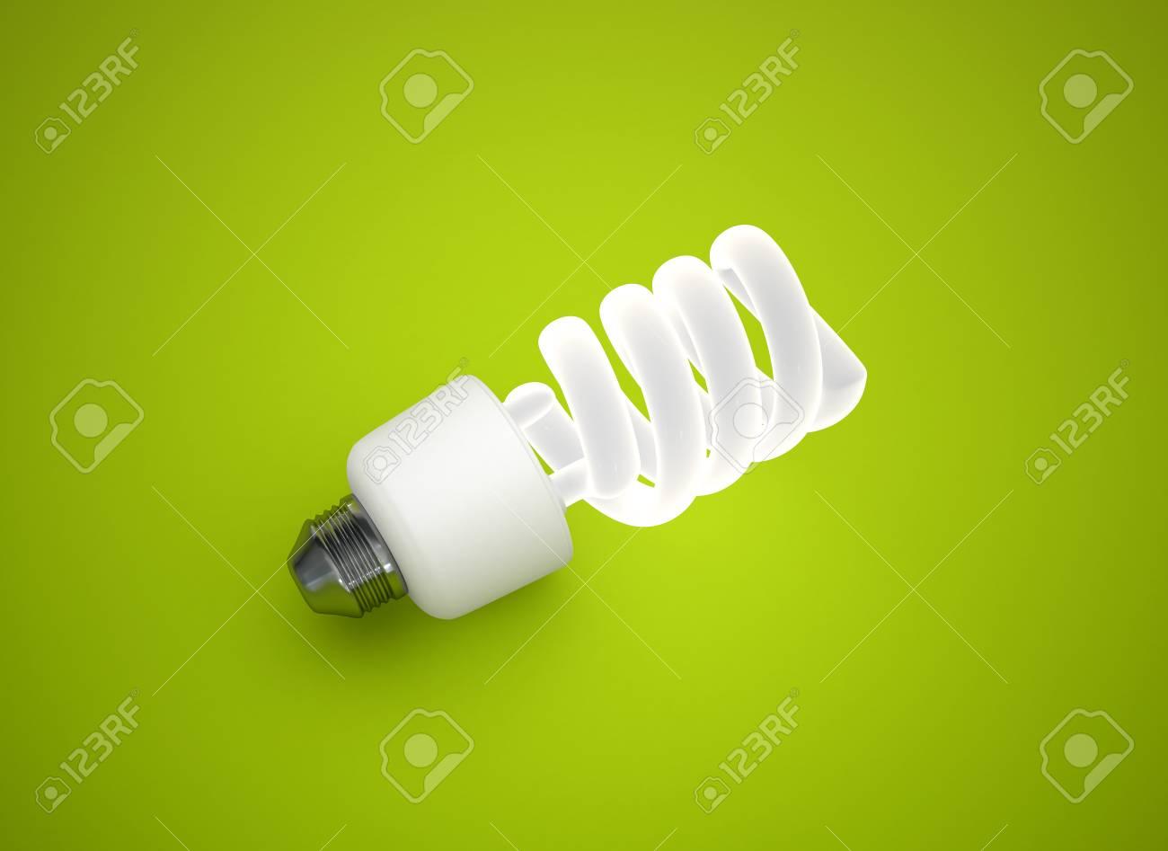 energy saving light bulb on green background Stock Photo - 8378424