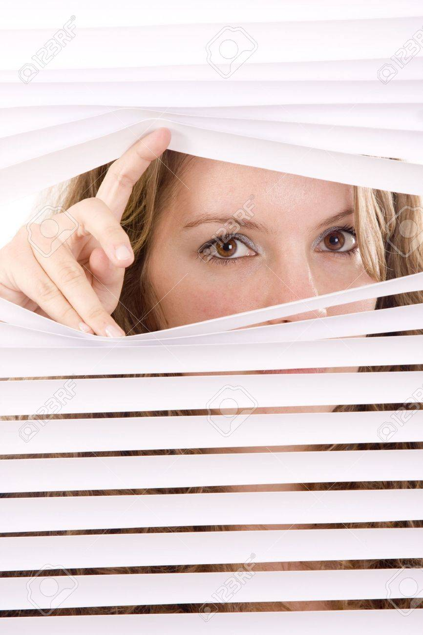 woman hands apart on the window blinds Stock Photo - 6535620