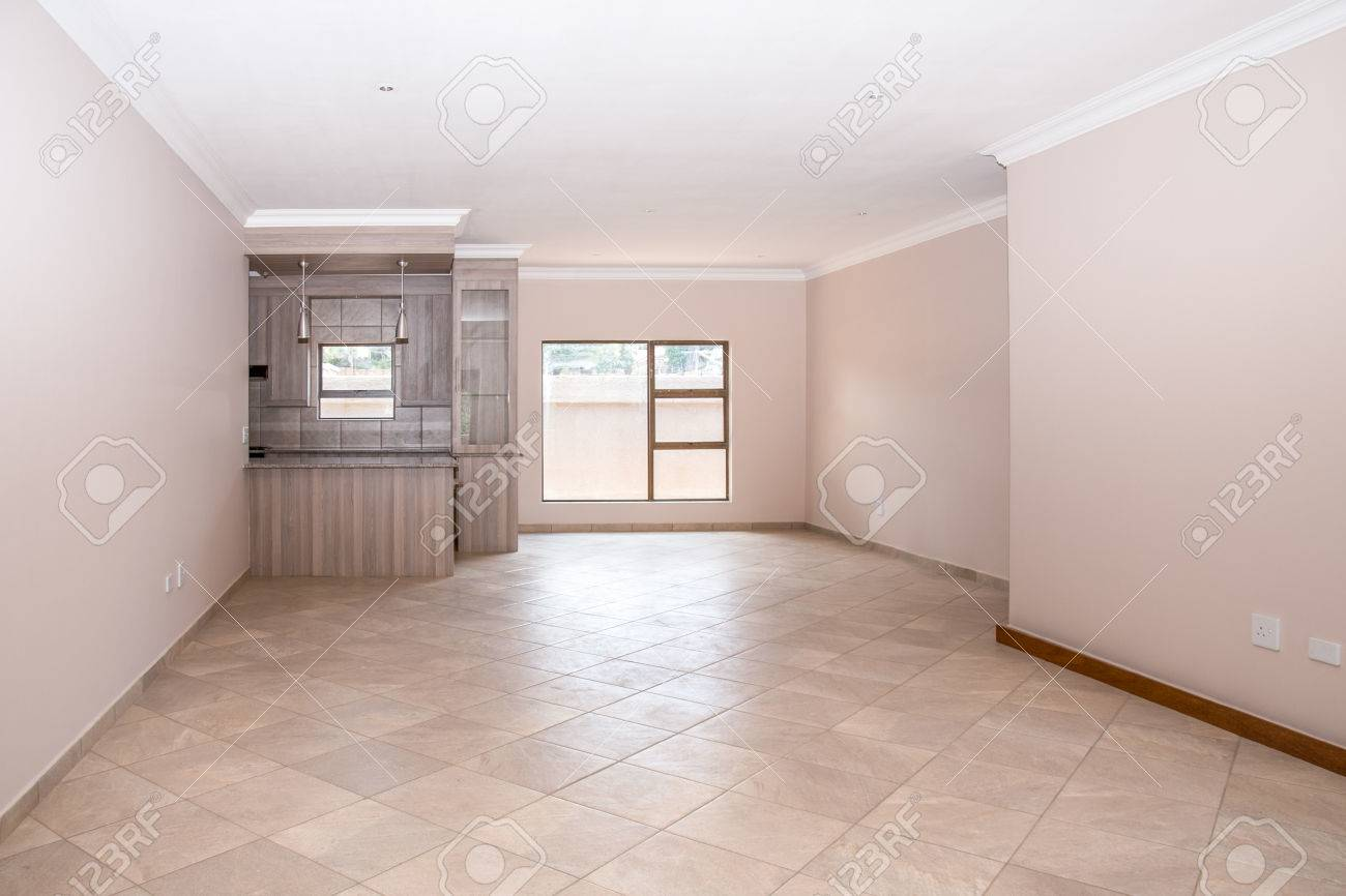 A Vacant Livingroom Of A Newly Build House, With Tiled Floors ...