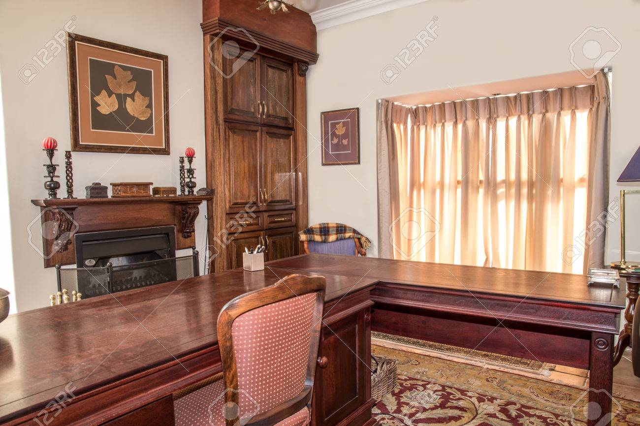 A private study in a residential home with wooden stydy table..
