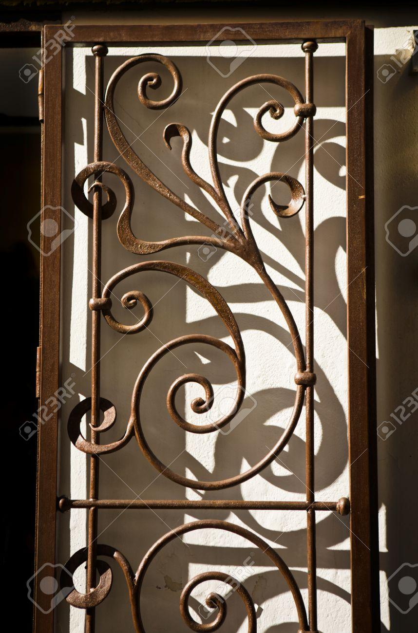 Nice wrought iron handicraft door casting shadows Cordoba Spain Stock Photo - 25169115  sc 1 st  123RF.com & Nice Wrought Iron Handicraft Door Casting Shadows Cordoba Spain ...