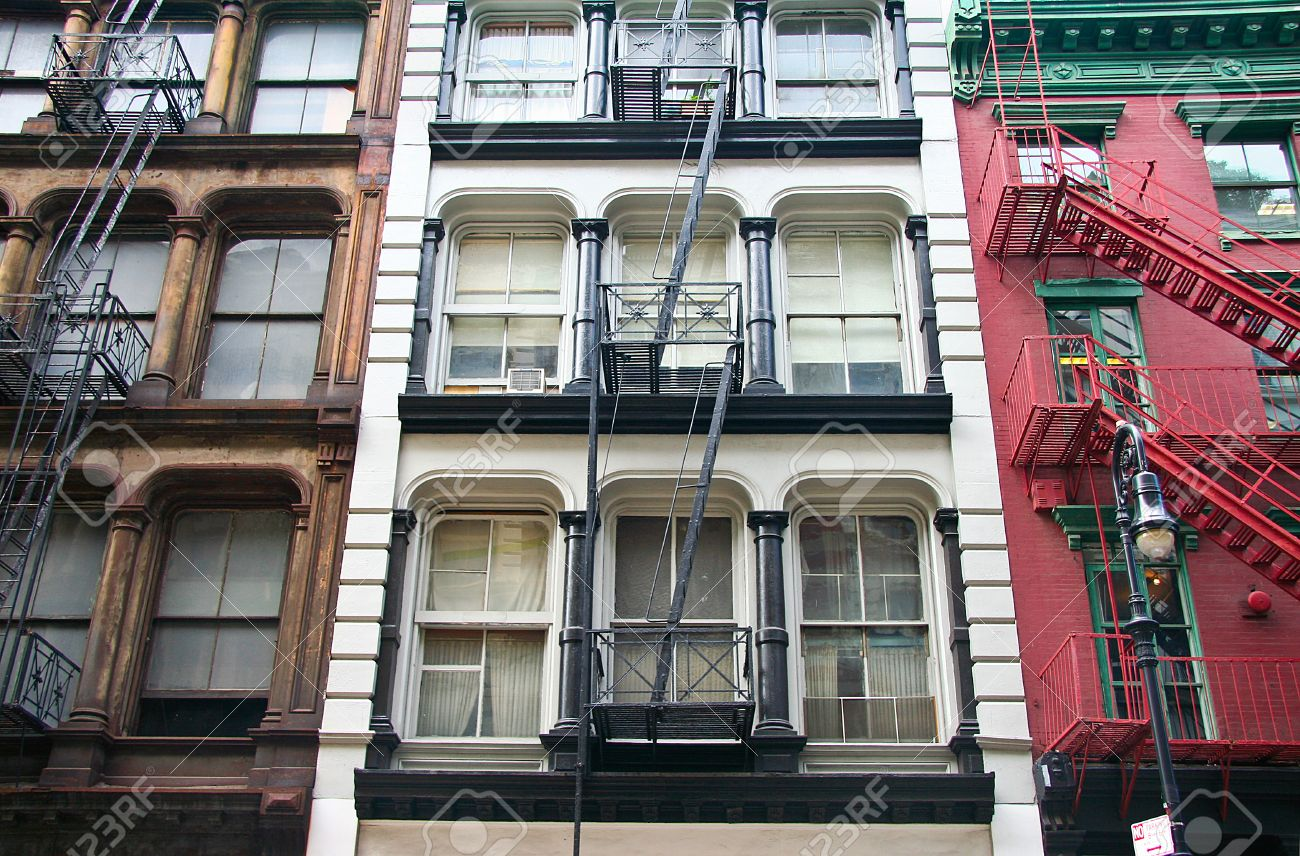 Stock Photo   Three Colorful, Red, Brown And White, Apartment Buildings  Facades With Emergency Escapes Typical New York City Rental Complexes With  Fire ...
