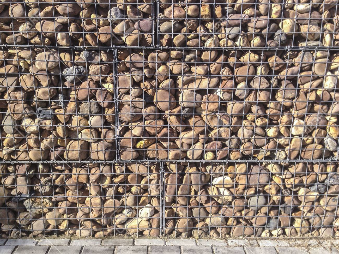 Wall Protected With River Pebble Stones In Iron Mesh This Structure