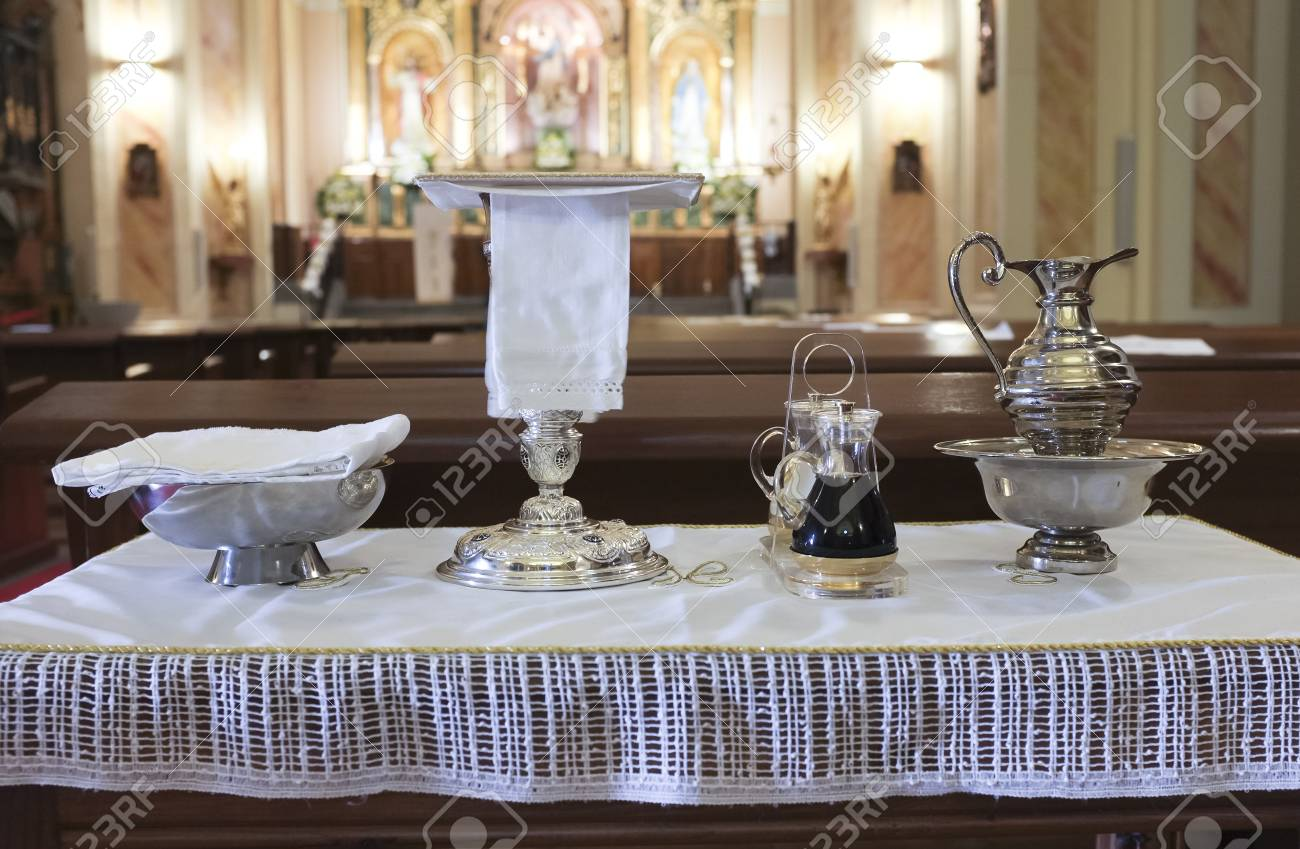 Catholic Liturgical Objects Displayed Over Table At Church