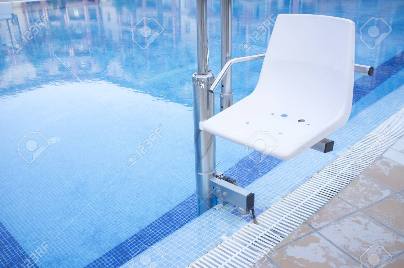 Swimming pool lift for disabled people access to the pool. Holidays..