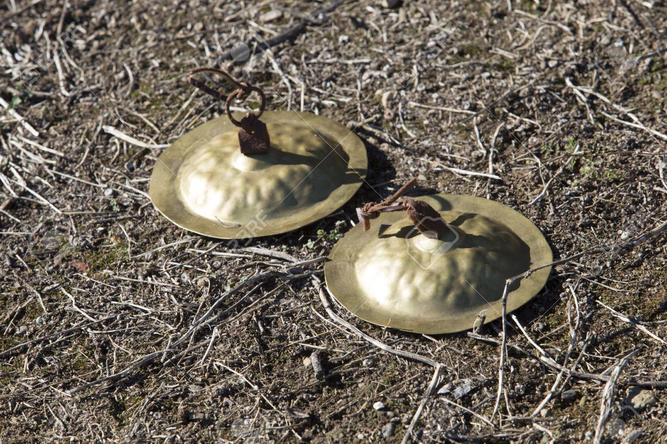 Golden ancient cymbals on the ground  Concave hemispherical discs