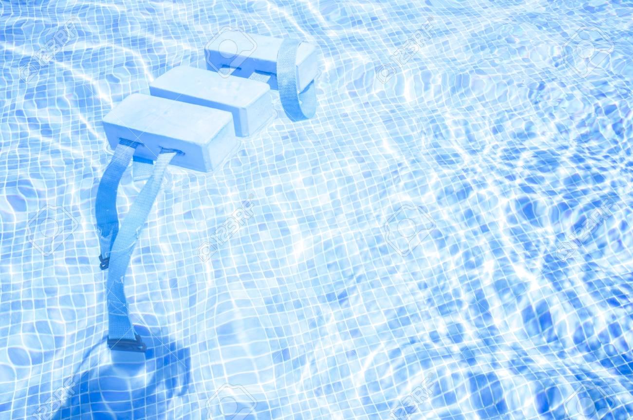 Swimming Float Belt for Kids Swim Training on swimming pool surface...