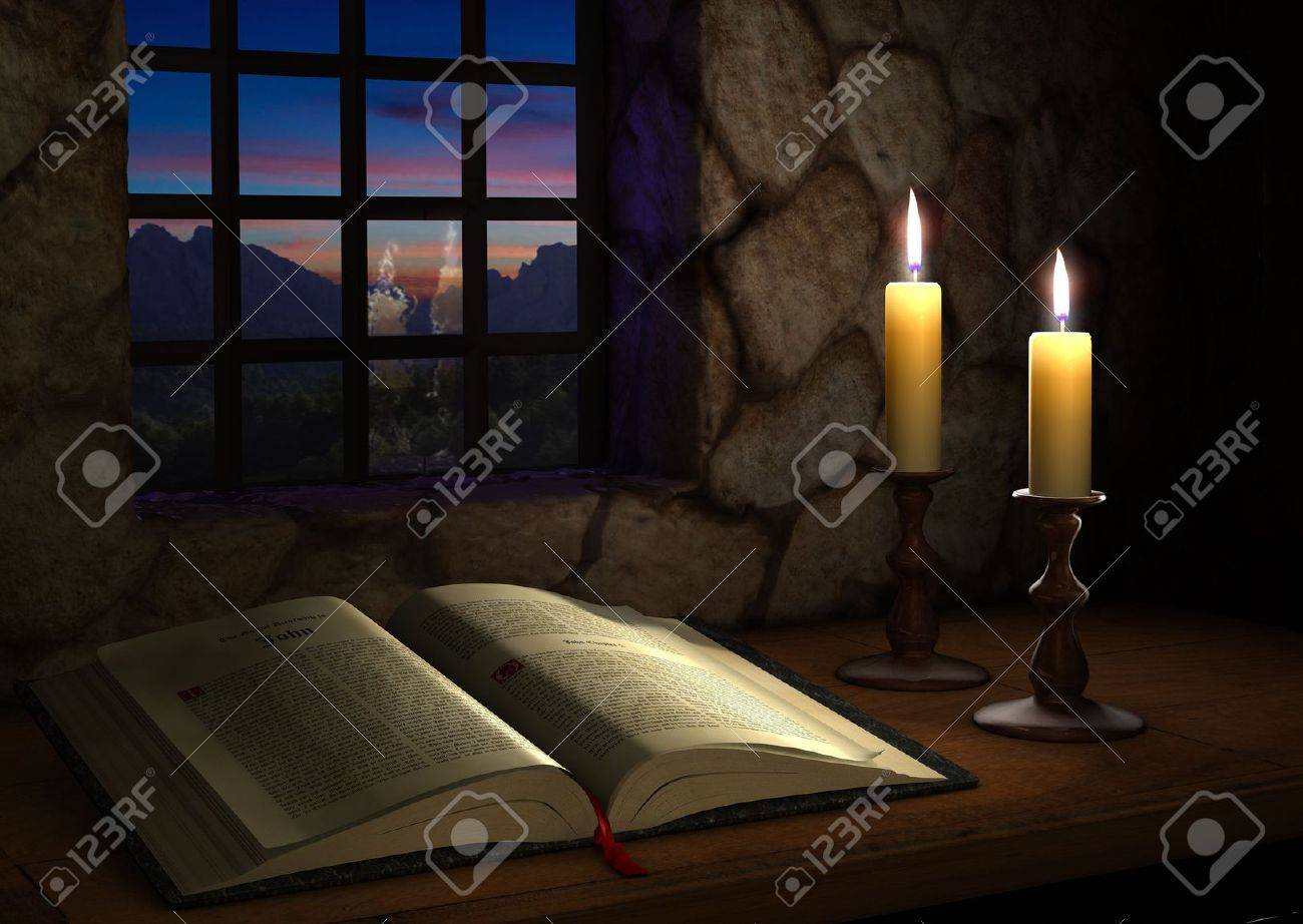 Open Bible illuminated by two candles in front of a window at dusk Stock Photo - 7038268