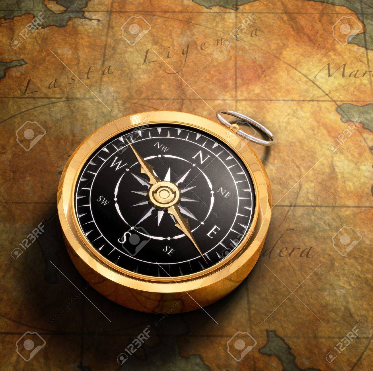 An old fashoned brass compass on a Treasure map background Stock Photo - 7059452