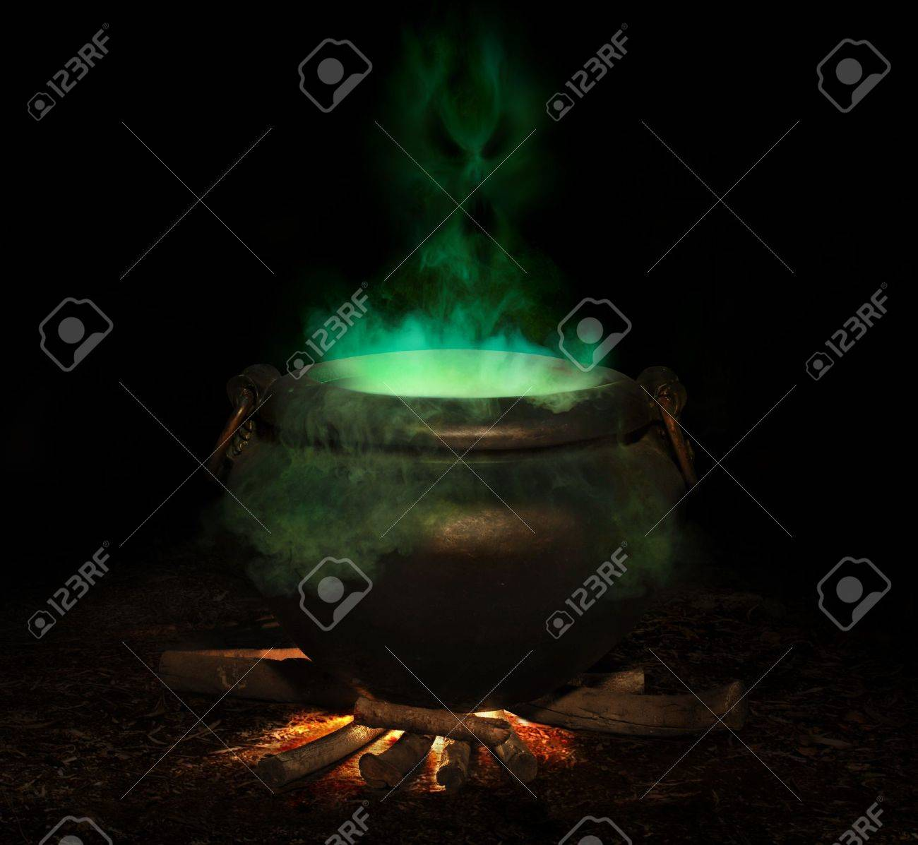 bubbling iron cauldron with green smoke and evil spirit rising Stock Photo - 7051365
