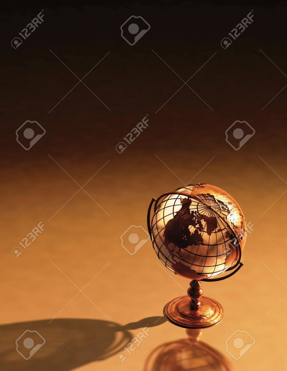 3D art showing a caged brass metalic structure of the earth. Stock Photo - 7053584