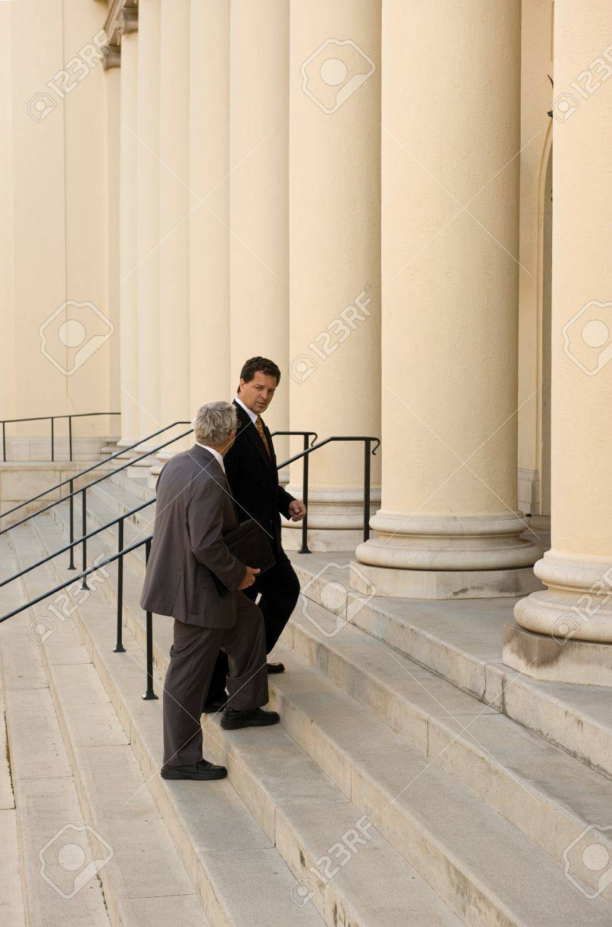 Attorney and client walking up the steps of a courthouse Stock Photo - 9519874