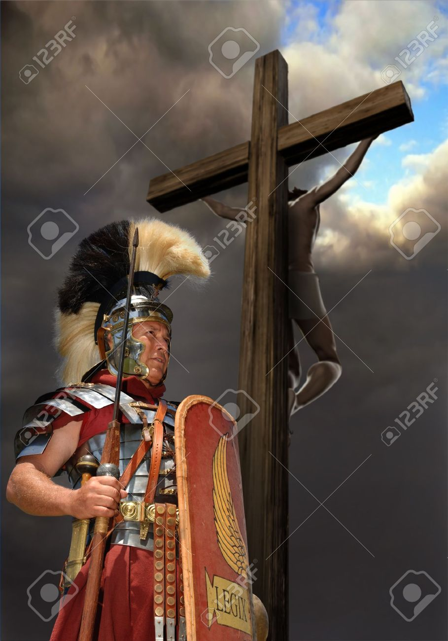 1st century Roman soldier in armour, rank of Optio shot against a stormy sky with Jesus on a cross in the background Stock Photo - 9539261