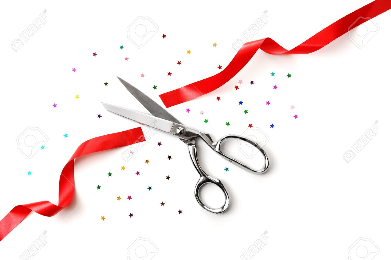 grand opening illustrated with a scissors a red ribbon and confetti