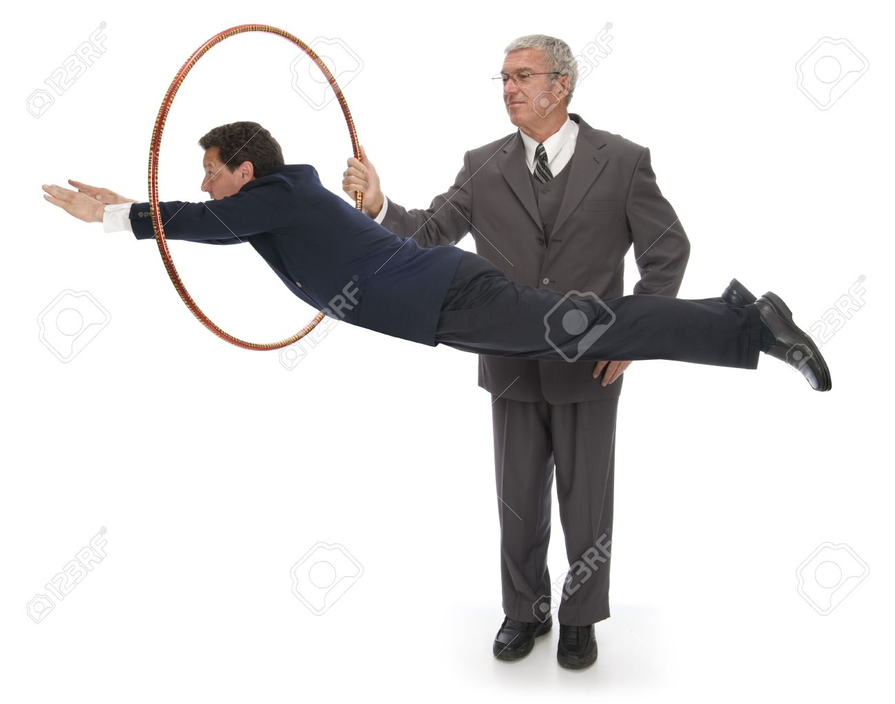 CEO holding up a hoop for his employee / client / vendor to jump through Stock Photo - 16947182