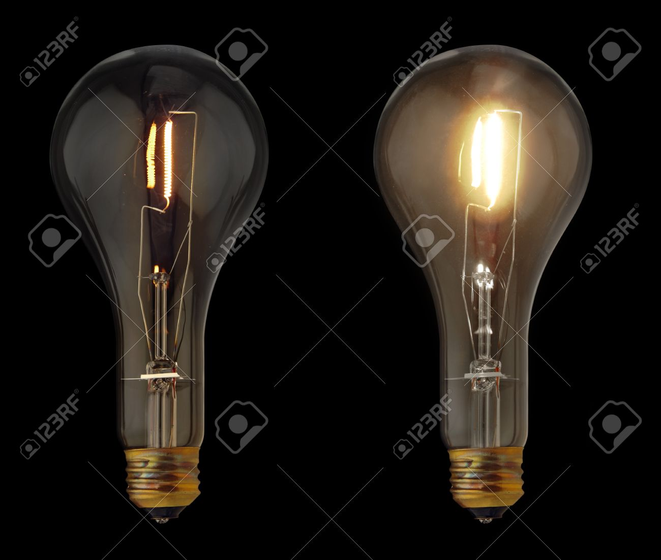 Good Stock Photo   Two Ideas Represented As One Dim Light Bulb And One Bright Light  Bulb Isolated On Black Nice Design