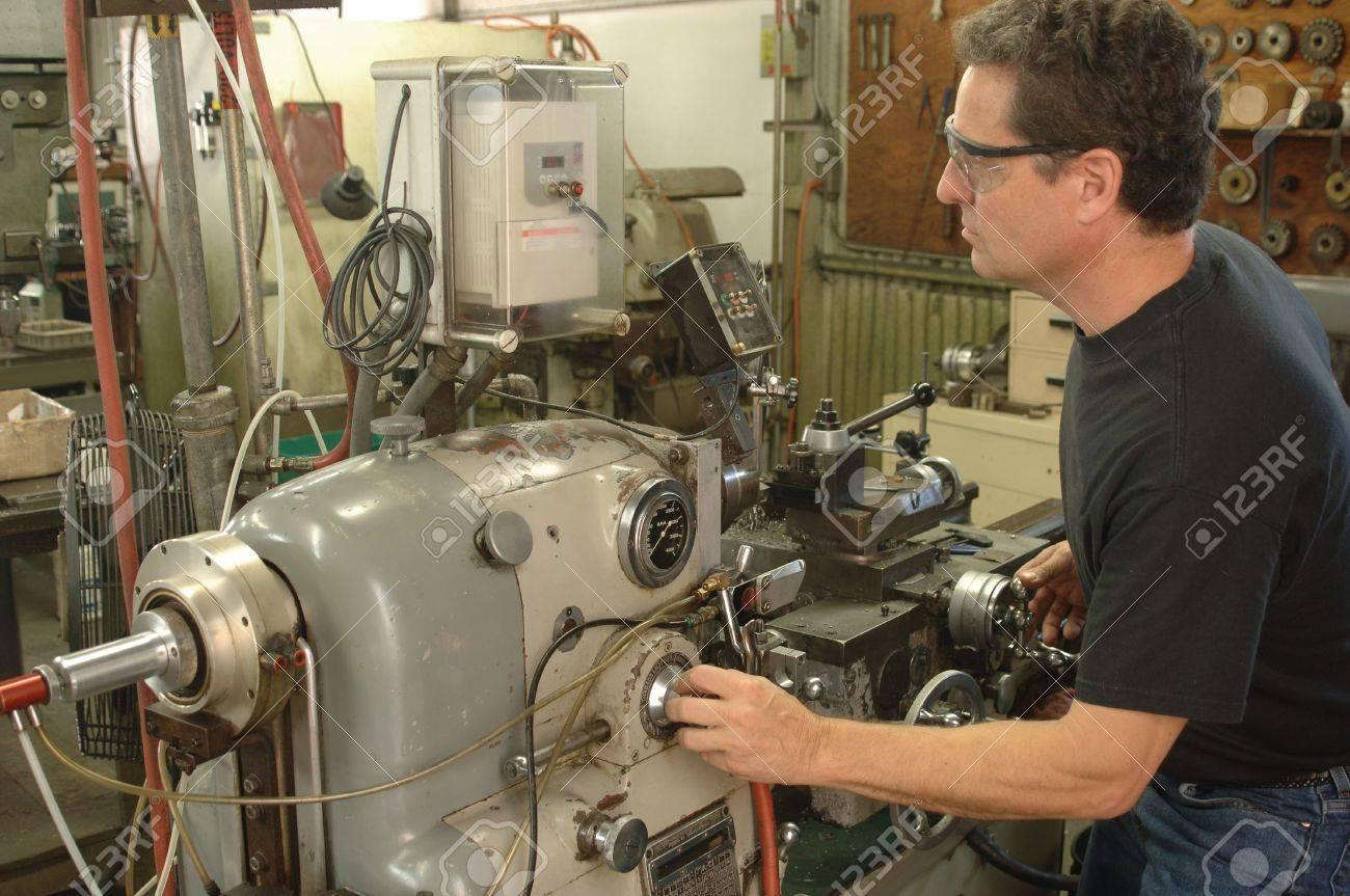 machinist lathe. machinist working a metal lathe stock photo - 9512796