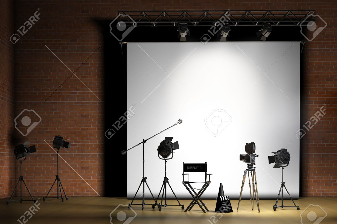 Directors Chair On Set - Movie set inside a sound stage with movie lights movie camera boom mic