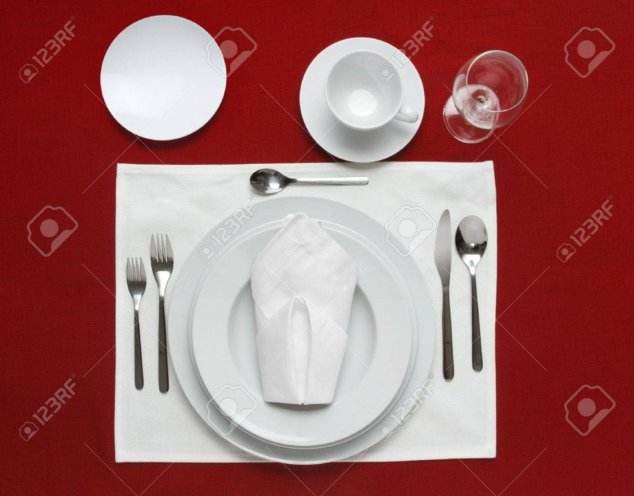 Full table place setting on a red table cloth Stock Photo - 7055366  sc 1 st  123RF.com & Full Table Place Setting On A Red Table Cloth Stock Photo Picture ...