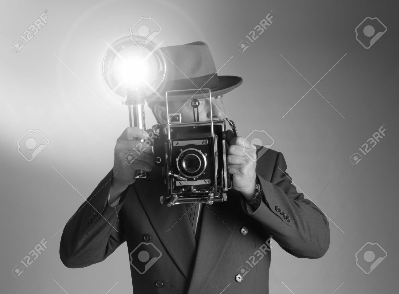 8f48bcc4a117e Black   White shot of a retro 1940 s stylephotographer wearing a Fedora hat  and holding a