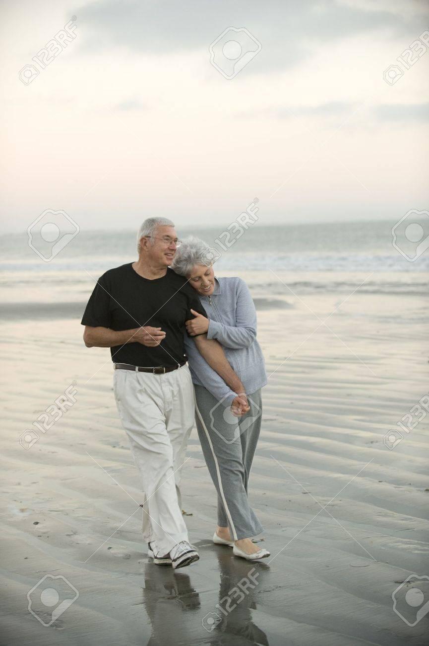 Senior couple walking the beach Stock Photo - 16947740