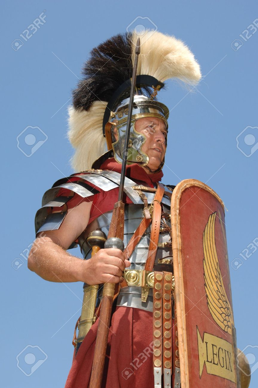 1st century Roman soldier in armour, rank of Optio shot against a blue sky Stock Photo - 16947981