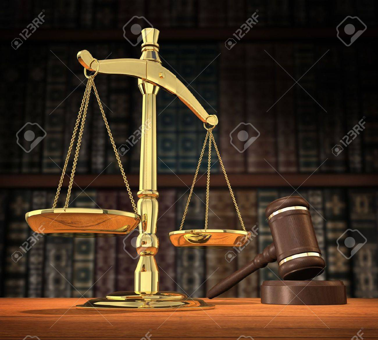 Scales of justice and gavel on desk with dark background that allows for copyspace. Stock Photo - 7054371