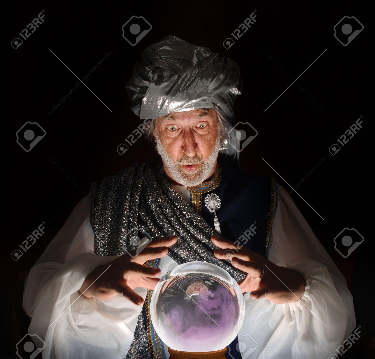 9519798-swami-gazing-into-a-crystal-ball