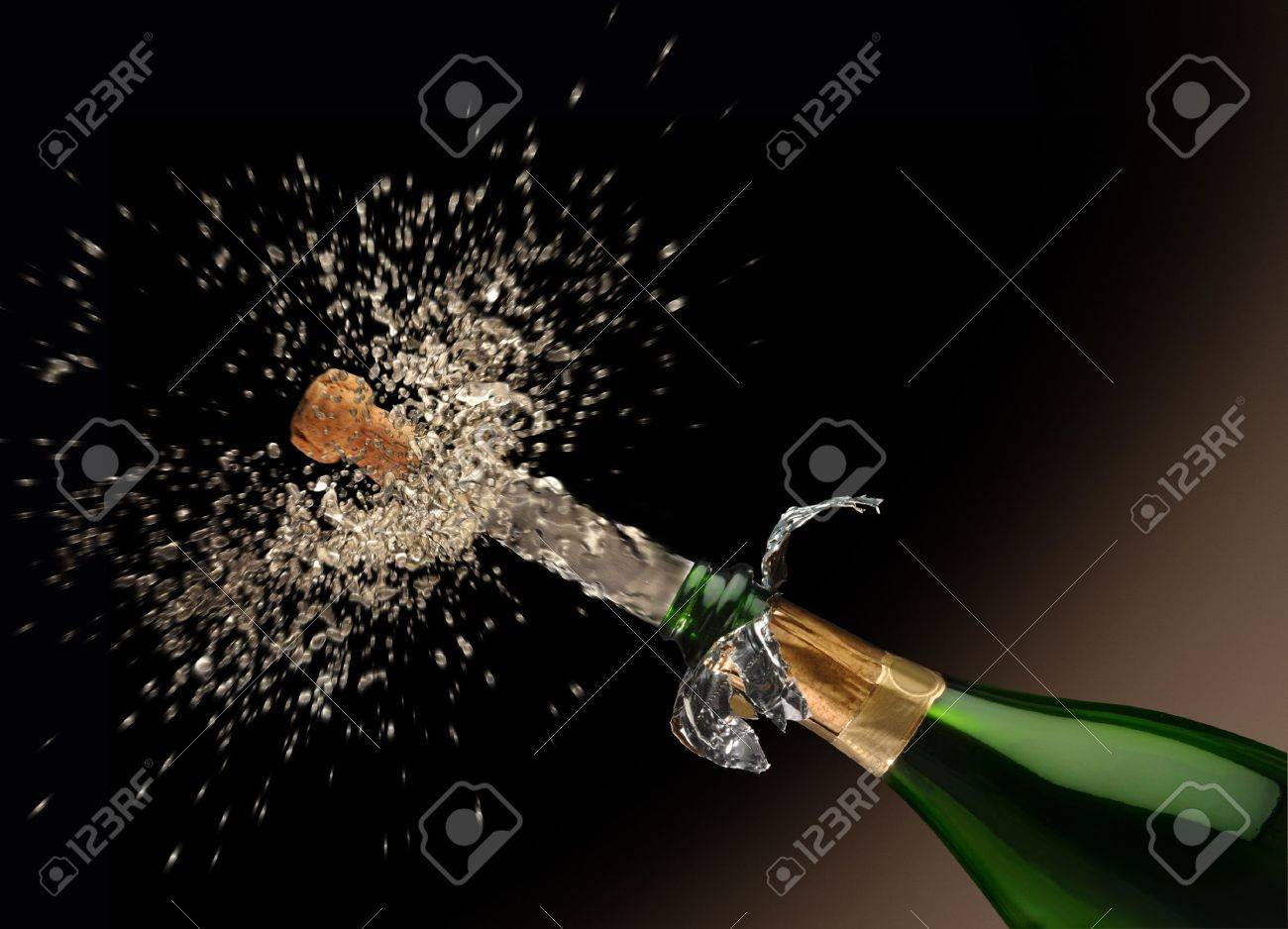 A Quark poping off of the champaign bottle with lots of splash! Stock Photo - 7057764